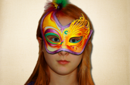 Purple Masquerade Mask with Golden Eye Details